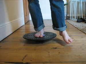 Proprioception exercise for ankle on wobble board